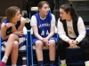 Senior Sophia Cusumano talks to seventh grade St. Peter's students Georgia Winfield, from left, and Eileen Harrington during their game at St. James Feb. 14. photo by Bridget Jones.