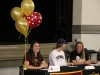 Seniors Kristina Coppinger, from left, Eleanor Lueke and Delaney Meyer smile after signing their letters of intent April 20 to play sports in college. photo by Maggie Knox