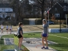 Freshman Devin John, left, watches as math teacher and track coach Ashley Walker explains how to do the triple jump. John has never competed in the event so Walker was teaching her how. photo by Mary Hilliard