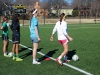 Junior Ellie Porterfield, from left, sophomore Elexa Piersen, junior Alyssa Seitzer and senior Taran Smith wait in line for a drill during soccer practice. Last year the STA soccer team got second place at State. photo by Mary Hilliard