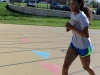 Junior Lauren McCann runs on the track duirng her practice April 3. photo by Kat Mediavilla