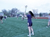 Senior Kristina Coppinger, center, practices a throwing drill at varsity lacrosse practice March 30. Coppinger has been on the varsity team for four years. photo by Maggie Knox