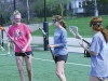 Seniors MaryMichael Hough, from left, Claire Finn and sophomore Hannah Steen talk during a varsity lacrosse practice warm-up drill March 30. photo by Maggie Knox