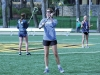 Senior Claire Finn, center, throws the ball during a warm-up at varsity lacrosse practice March 30. photo by Maggie Knox