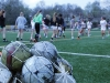 The varsity soccer team warms up March 30 before practice with stretching and running drills. photo by Maggie Knox