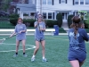 Senior Gabby Clemente, center, waits for a pass from junior Meggie Mayer, right, at varsity lacrosse practice March 30. The STA lacrosse team is the reigning State Runner-Up. photo by Maggie Knox