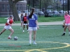 Freshman Lily Farkas, left, dribbles the ball towards the goal March 30 during varsity soccer practice. photo by Maggie Knox