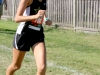 Sophomore Mia Schloegel runs in the varsity race at Johnson County Community College. STA varsity finished 9th out of 11 teams. photo by Kate Scofield