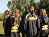 Cross country runners wait to watch the Varsity race in Kearney Oct. 10. photo by Anna Hafner