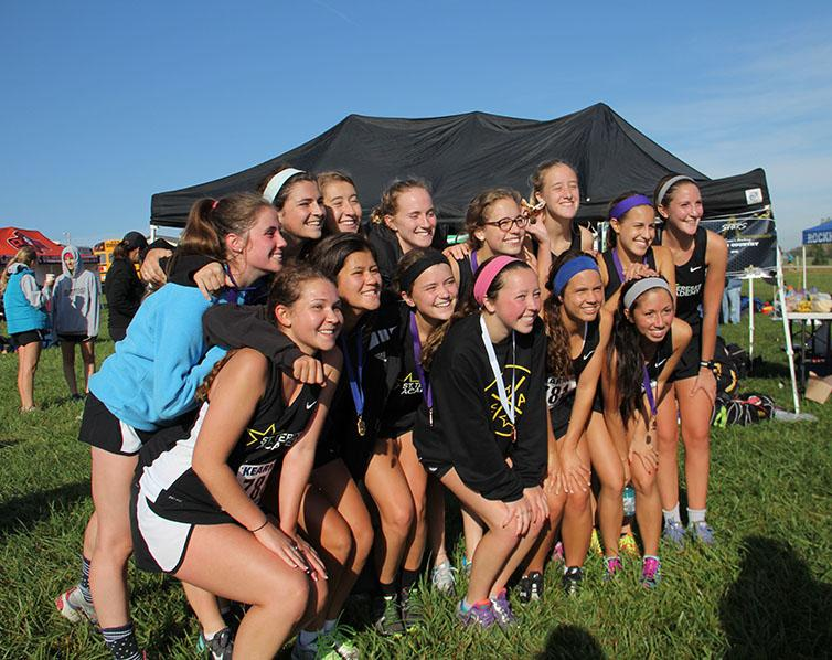 STA cross country seniors pose for a photo after the Kearney meet Oct. 10. Emily Laird is the only senior from the team running post-season. photo by Anna Hafner
