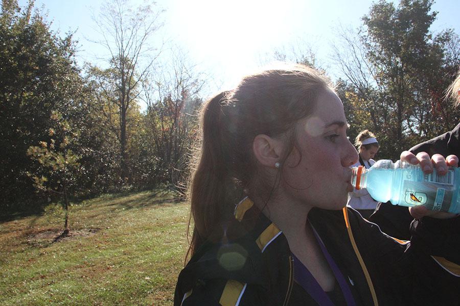 Senior Kay VanAsdale drinks a gatorade following the JV race in Kearney Oct. 10. photo by Anna Hafner