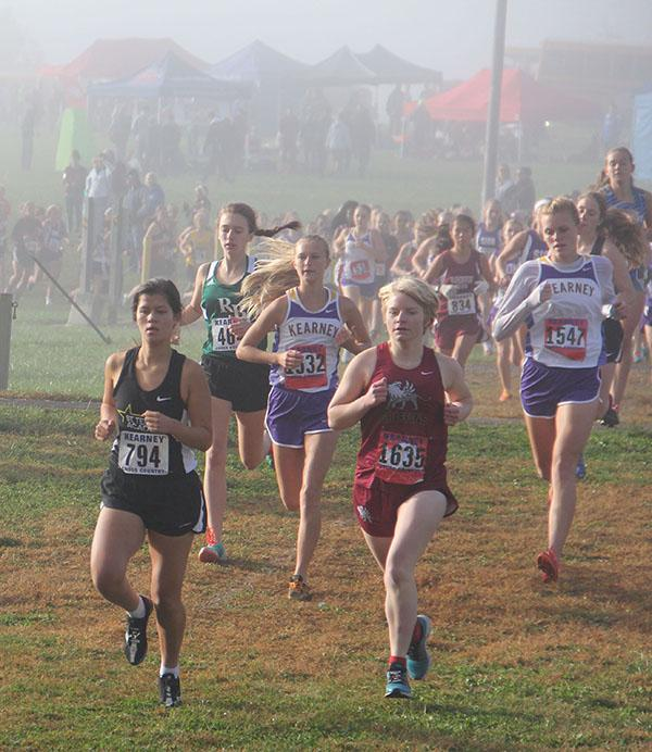STA cross country senior Sarah Cigas, left, leads a group of runners at the Kearney meet Oct. 10. photo by Anna Hafner