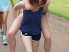 Sophomore Reilly Donnelly gives sophomore Margaret Jordahl a piggyback ride at the STA Singers retreat Aug. 20. photo by Madi Winfield