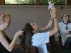 Senior Mary LePique, left, braids junior Natalie Kistler's hair as junior Courtney Talken laughs at the STA Singers retreat Aug. 21. photo by Madi Winfield
