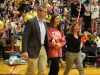 Students cheers for four year varsity basketball team manager Claire McHugh as she is walked onto the court by her parents Tom, left, and Stephanie McHugh. Wednesday Feb. 24 was STA senior night for both basketball and dance team. photo by Kat Mediavilla