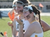 Junior Mary Hilliard, front, converses with junior Kristina Coppinger at the varsity lacrosse game against Sion March 31. The Stars defeated the Storm 19-4 at STA. photo by Siobhan Miller