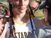 Junior Kristina Coppinger listens to head coach Jessica Hanna at the varsity lacrosse game against Sion March 31. The Stars defeated the Storm 19-4 at STA. photo by Siobhan Miller
