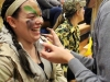 Senior Katie Donaldson, right, applies face paint to the face of Lauren Ryan. STA students dressed in a camouflage theme.  photo by Kat Mediavilla