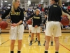 Brynn Slattery, left, Clare Herrington and Grace Kitts warm up with some passing drills before playing Bishop Miege High School. The STA Stars lost 47-34 to the BMHS Stags. photo by Kat Mediavilla