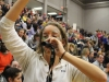 Senior Zoe Jackson blows on a duck call to cheer on the Stars while they played the Bishop Miege Stags. STA students dressed in a camouflage theme to cheer on the basketball team. photo by Kat Mediavilla