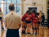 The Bishop Miege varsity volleyball team huddles in between plays during their game against St. Teresa's in the Goppert Center Sept. 21. photo by Cassie Hayes