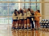 The St. Teresa's varsity volleyball team breaks after a huddle during their game versus Bishop Miege in the Goppert Center Sept. 21. photo by Cassie Hayes