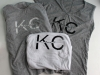 A stack of KC local screen printed t-shirts rest on Jewell Allen's work table. The Allen sisters work together to create this shirts to sell. photo by Kat Mediavilla