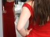 Senior Sarah Gorden poses in the mirror with her homemade prom dress. photo by Paige Powell