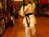 Sophomore Talia Parra practices karate during her lesson. Parra recently received her black belt in karate. photo by Gabby Martinez