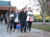 Members of the STA volleyball team Gabby Wimes, from left, Jacque Smith, Zoe Jackson and Emma Runyan exit the Goppert Center. The team was met in the quad after period one of Thursday Oct. 29 to be supported by fellow students, faculty and staff. photo by Kat Mediavilla