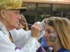 Junior Samantha Panis, right, gets her face painted during student appreciation day April 29. photo by Anna Hafner