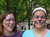Juniors Jamie Hafenstine, left, and Macy Trujillo smile after getting their faces painted during student appreciation day April 29. photo by Anna Hafner