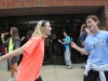 Seniors Meg Thompson, left, and Mary Hilliard sing and dance in front of the Goppert Center during student appreciation day April 29. photo by Anna Hafner