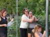 Sadie Green hugs her mom Janet Green, while Coach Lana Krause reads Sadie's favorite memories on Senior Night Sept. 24.