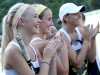 Sophomore Meg Thompson, from left, juniors Amy O'Leary and Sydney Edmonds clap for their teammates during a match against St. Joseph Central High School Sept. 25 at Homestead Country Club. The cheers started as each player was announced before the match.