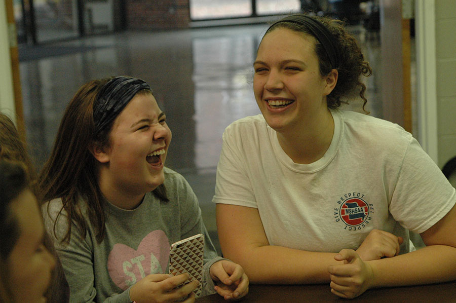 Junior Catelyne Campbell, left, and Senior Natalie Hull laugh as they celebrate Thanksgiving in their advisories. Campbell is apart of the Whitney advisory and Hull is a member of the O\'rear advisory. photo by Riley McNett