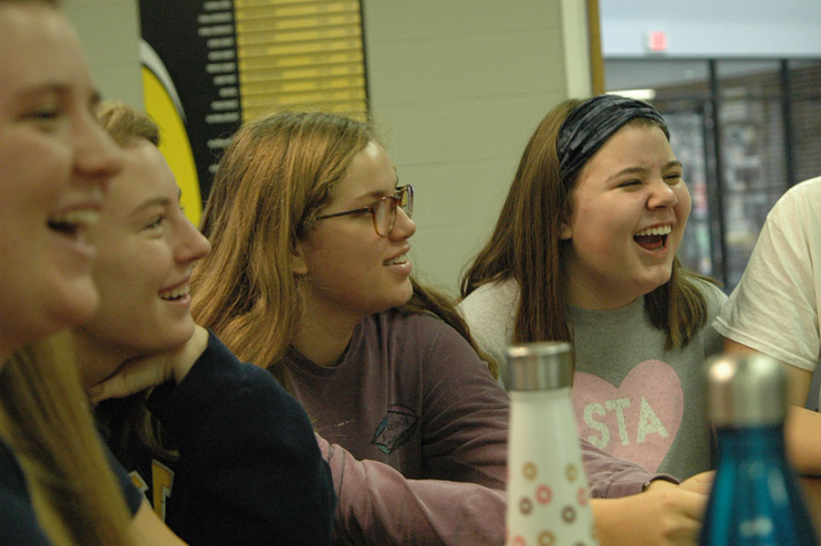 Juniors, from left, Olivia Matlock, Mamie Murphy, Lily Manning, and Catelyne Campbell laugh as they celebrate Thanksgiving with each other. The O\'rear and Whitney advisory celebrated together. photo by Riley McNett