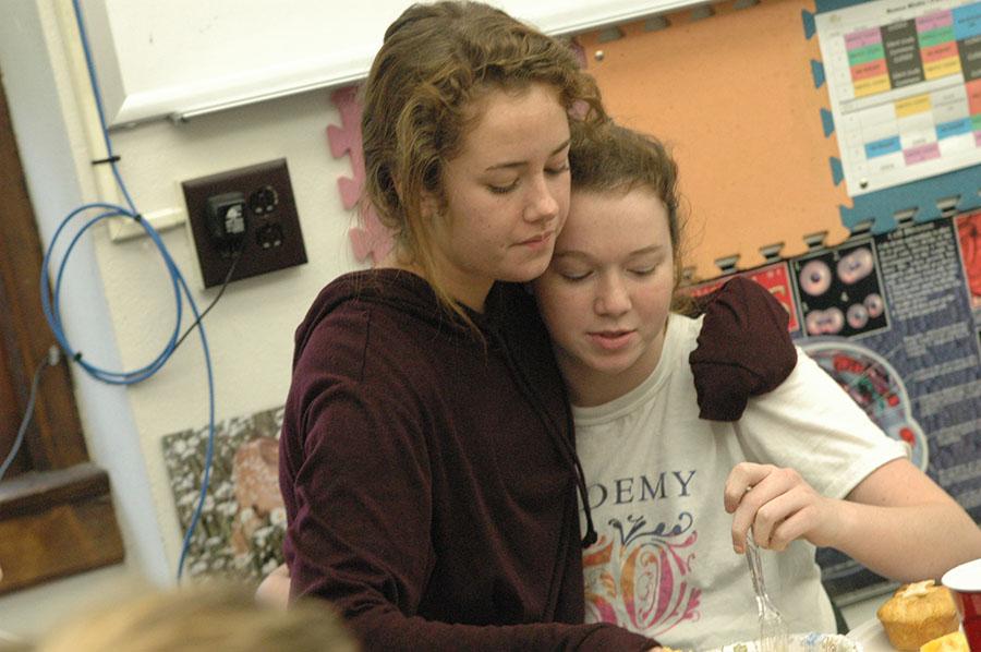 Alum Kailey McNett hugs senior Lizzy Williams as she comes back to visit STA. McNett was apart of the Blake advisory. photo by Riley McNett