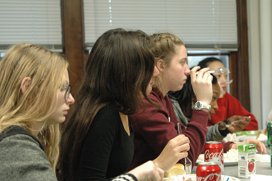 Juniors, from left, Cassidy Schuster, Emily Zapien, and Grace Oest converse with classmates as they celebrate Thanksgiving in their advisories. photo by Riley McNett