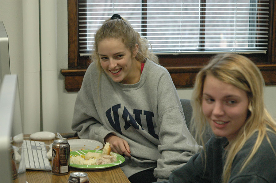 Sophmores Ann Leverich and Mallory Batliner smile at another classmate as they enjoy Thanksgiving in publications teacher, Brad Lewis\' room. photo by Riley McNett