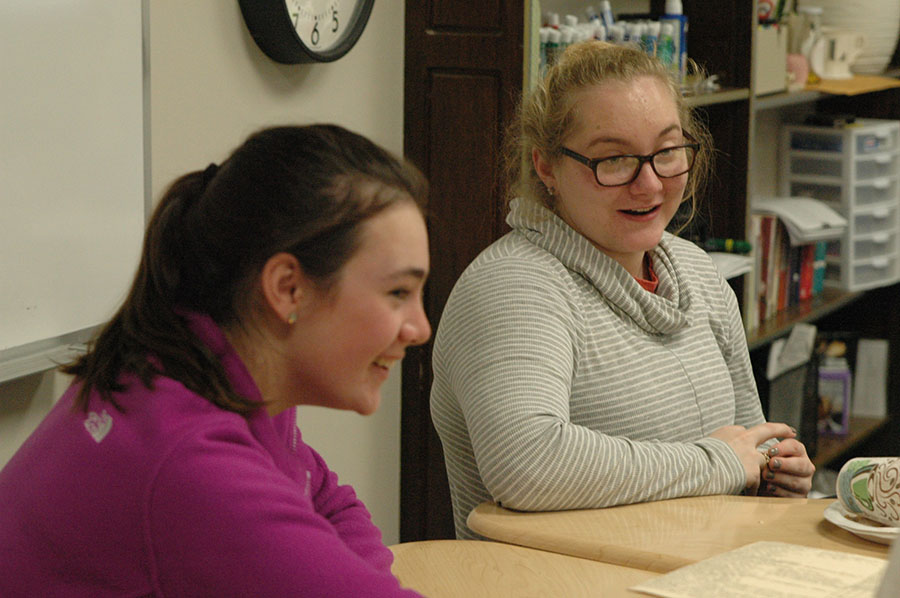 Junior Emily Vosburgh and Senior Aimee Barthol smile and converse with other members of their advisory during Thanksgiving feasts on Tuesday, November 22nd. Vosburgh and Barthol are members of the Duff advisory. photo by Riley McNett