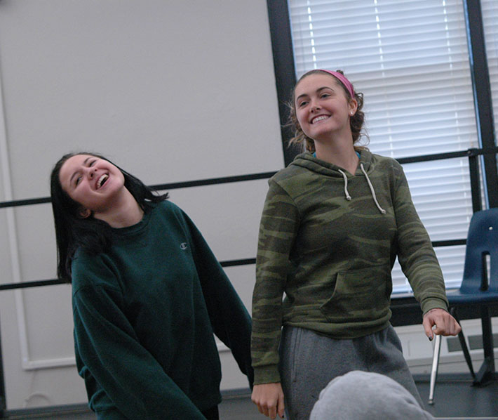 Juniors, from left, Angie Medina and Monica Looney laugh as they dance to