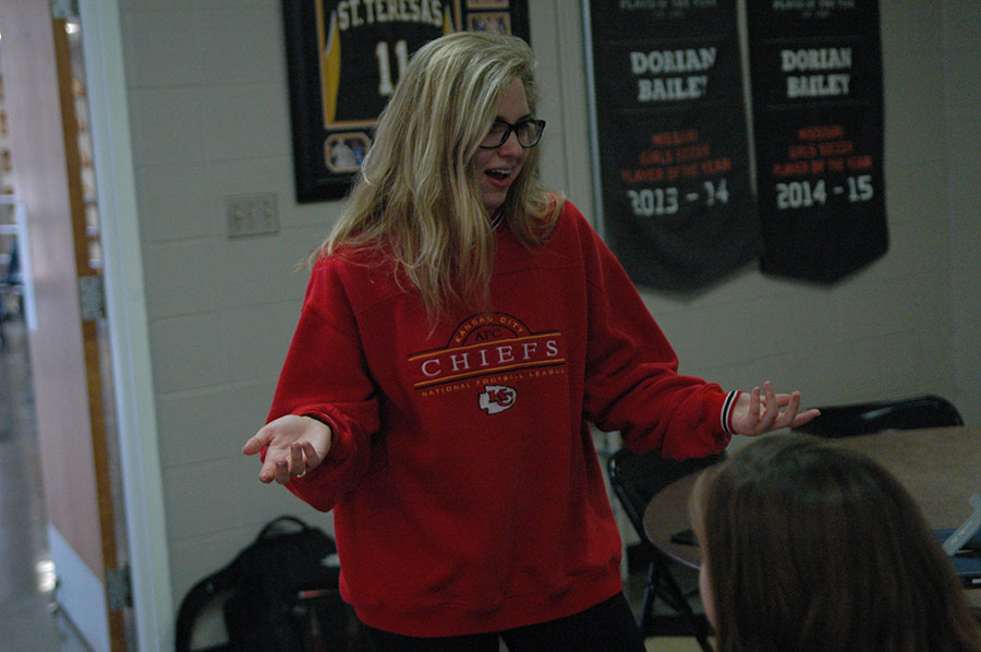 Senior Claire Fiorella converses with fellow classmates during advisory Thanksgiving feasts on Tuesday, November 22nd. Fiorella is a member of the Whitney advisory. photo by Riley McNett