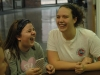 Junior Catelyne Campbell, left, and Senior Natalie Hull laugh as they celebrate Thanksgiving in their advisories. Campbell is apart of the Whitney advisory and Hull is a member of the O'rear advisory. photo by Riley McNett