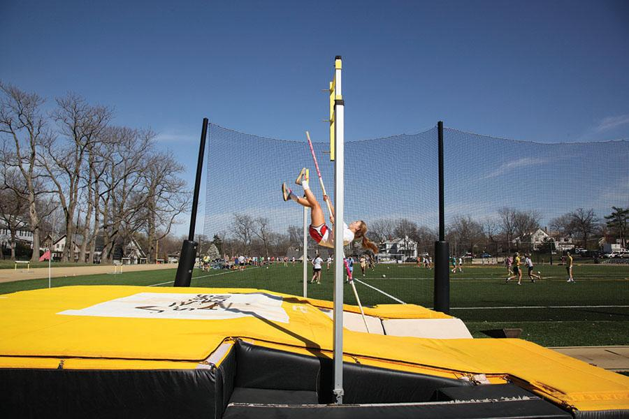 Senior Carson Beineman angles her body to maximize jump height during varsity pole vaulting practice March 31. photo by Arinna Hoffine