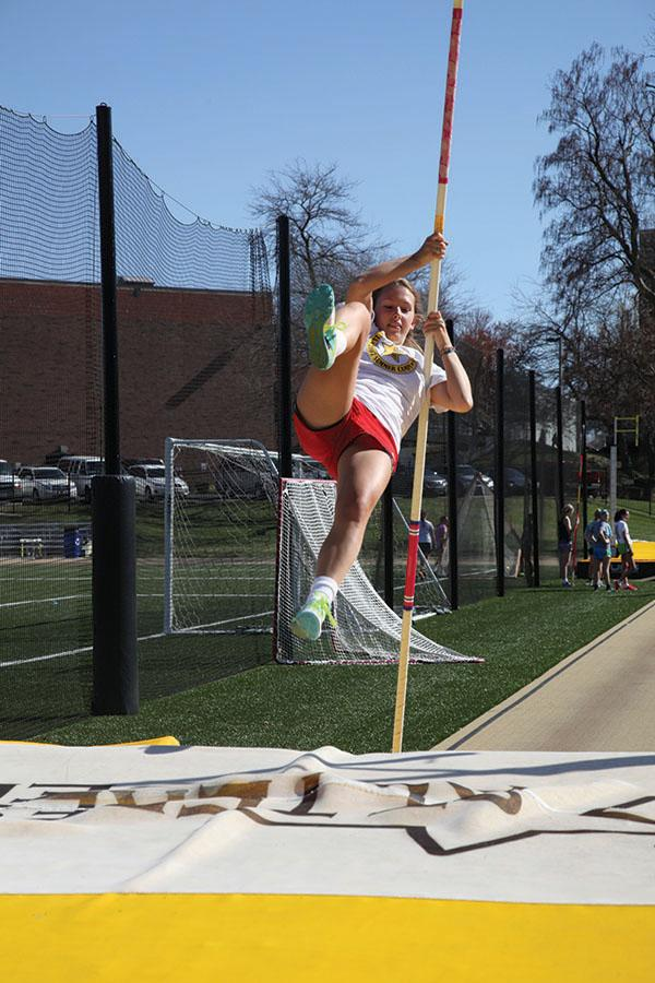 Senior Carson Beineman sores over the mat during pole vaulting practice March 31. photo by Arinna Hoffine