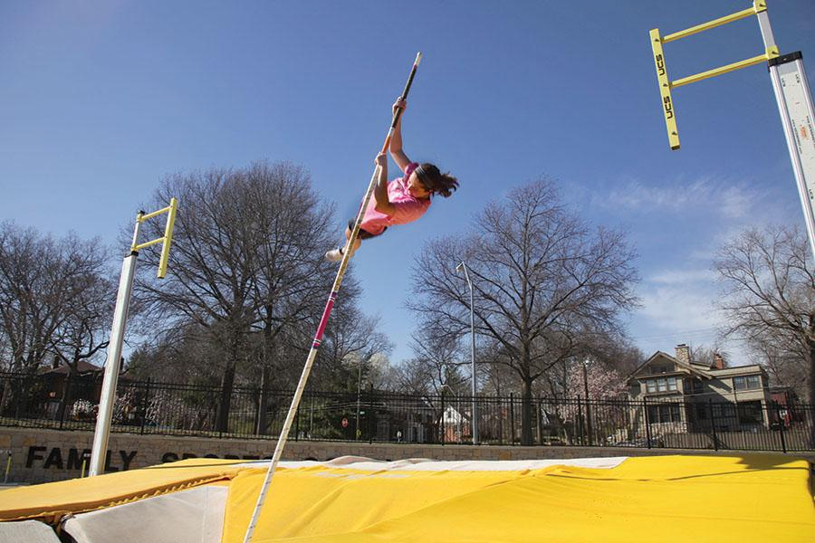 Senior Molly A. Mullen practices pole vaulting March 31. Mullen has been on the track team since her freshman yea. photo by Arinna Hoffine