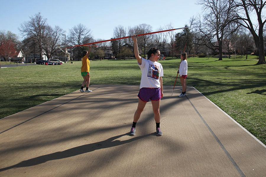 Junior Gillian Cutter, left, freshman Sofia Giocondo and junior Kathleen Herrington practice throwing javelin March 31. This is the first year javelin has been offered. photo by Arinna Hoffine
