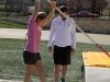 Senior Molly A. Mullen is assisted by coach Ryan Hayes with pole vaulting March 31. photo by Arinna Hoffine