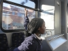 Sophomore Jasia Tolbert pulls the pullstring on the KC Ride bus to signal to the driver to stop at the upcoming bus stop Nov. 29. photo by Alex Davis